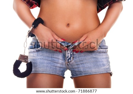 Sexy woman wearing blue jeans and handcuffs- isolated on white - stock photo