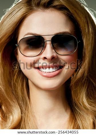 Sexy woman wearing sunglasses.beautiful smile. - stock photo