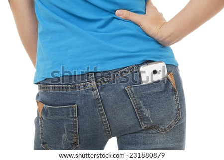 Sexy woman with a cell phone in her back pocket on a white background - stock photo