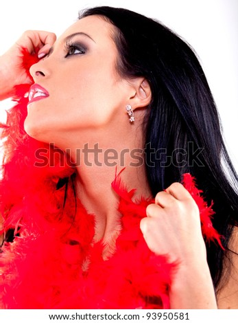 Sexy woman with a red feather boa - isolated over a white background - stock photo