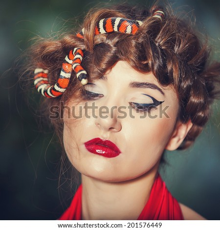 sexy woman with a snake - stock photo
