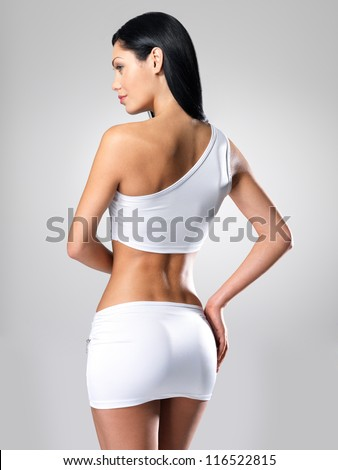 Sexy woman with beautiful slim body - model posing at studio - stock photo