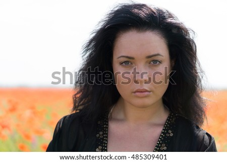 sexy woman with black hair and blue eyes is look mysterious