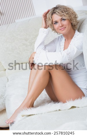 sexy woman with blonde hair in a bedroom  - stock photo