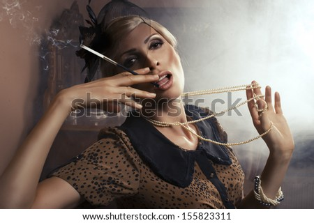 Sexy woman with cigarette - stock photo