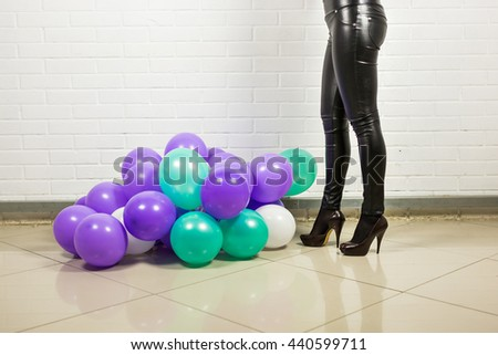 Sexy woman with colored balloons - stock photo