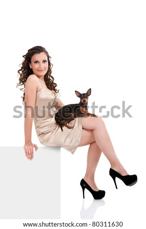 sexy woman with dog sitting on blank billboard, isolated on white background - stock photo