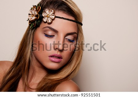 sexy woman with flowers in hair - stock photo
