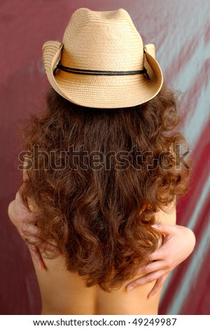 Sexy woman with long brown hair in cowboy - stock photo