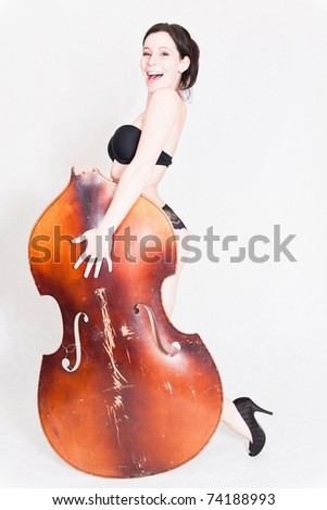 sexy woman with part of contra-bass - stock photo