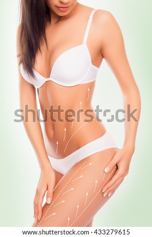 sexy woman with perfect figure and drawing arrows on it touching her hips. - stock photo