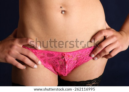 Sexy woman with pink lace panties - front view - stock photo