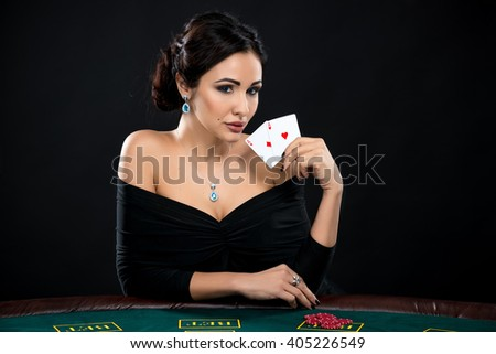 sexy woman with poker cards and chips - stock photo