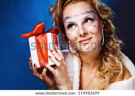 sexy woman with present wrapped in white paper - stock photo