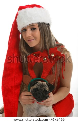 sexy woman with pug wearing christmas santa red hat - stock photo