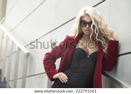 Sexy woman with sunglasses in city  - stock photo