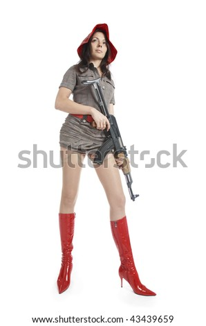 Sexy woman with weapon on white background