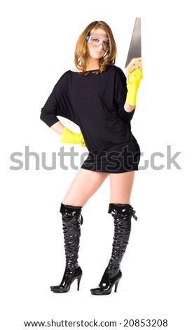 Sexy woman worker with saw. Isolated on white. - stock photo