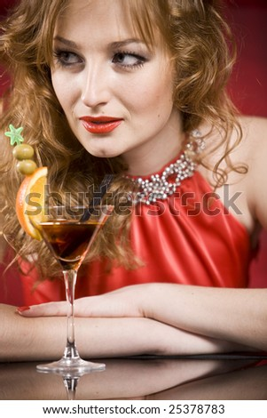 sexy women in red dress with cocktail