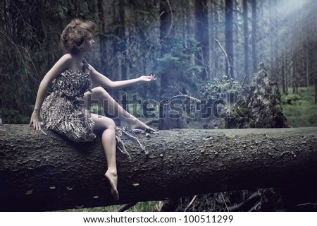 Sexy women sitting on the tree - stock photo