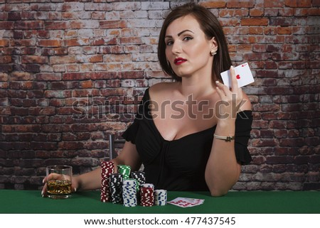Sexy women with glass of drink at the poker table casino chips