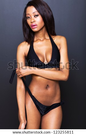 sexy young african american woman on black background - stock photo