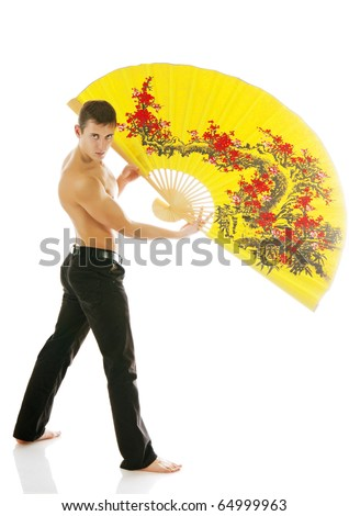 sexy young athletic man with yellow fan.  Isolated on white