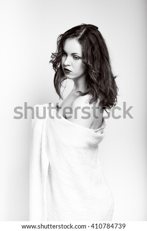 sexy young beautiful woman wrapped in a plaid closeup isolated on white background
