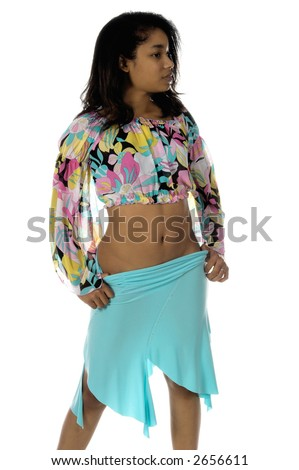 Sexy young Black woman in a blue skirt and a retro 60's pattern cropped blouse