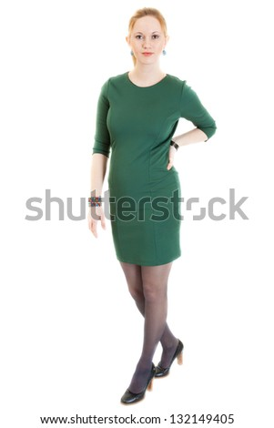 sexy young blonde woman wearing a green dress, black panti-tights and black sandals - stock photo