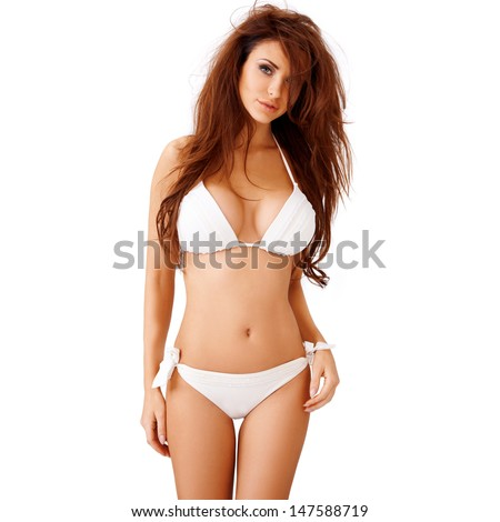Sexy young brunette woman with large breasts posing in a white bikini  three quarter isolated studio portrait - stock photo