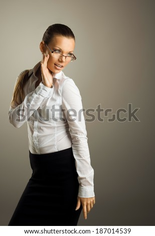 Sexy young business woman in glasses - stock photo