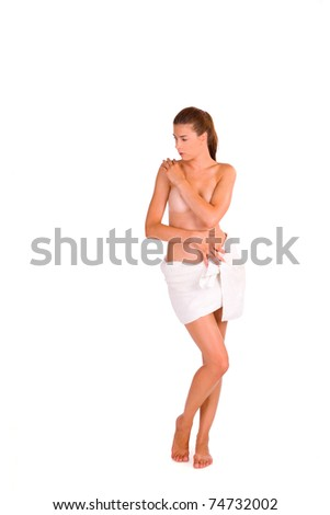 Sexy young Caucasian woman covering herself with a white towel