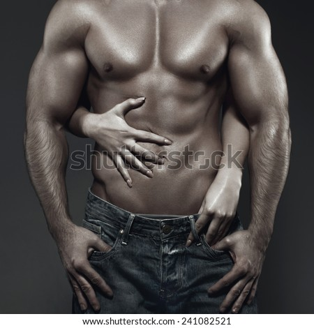 Sexy young couple body in dark, woman embrace man abs - stock photo