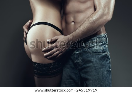 Sexy young couple body together at night, foreplay, closeup - stock photo