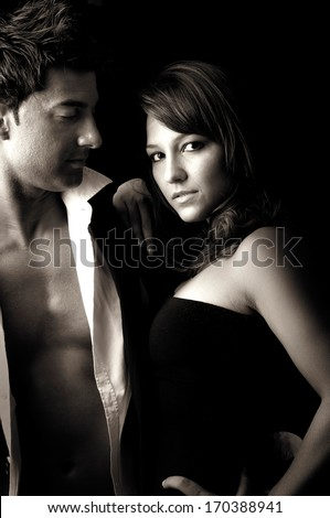 Sexy young couple in black and white - stock photo