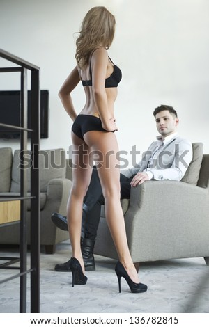 Sexy young couple in room.  - stock photo