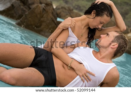 Sexy young couple on beach in underwear - stock photo