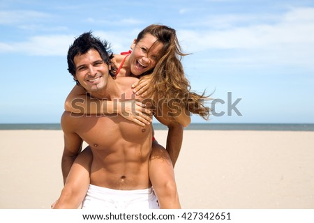 Sexy young couple on the beach