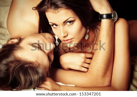 Sexy young couple playing in love games in a bedroom. - stock photo