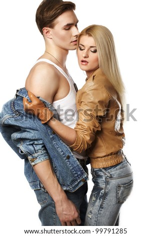 Sexy young couple wearing jeans in the studio - stock photo