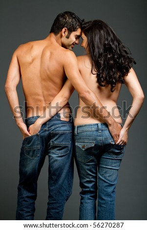 Sexy young couple with blue jeans standing together - stock photo