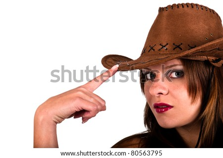 Sexy young cowgirl tapping her hat - stock photo