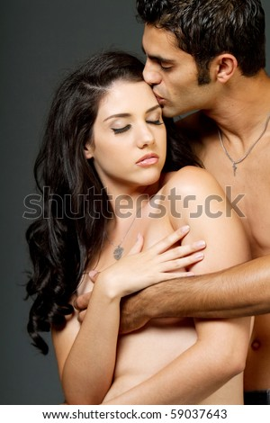 Sexy young ethnic couple having a romantic moment - stock photo