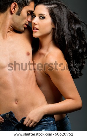 Sexy young ethnic couple in love - stock photo