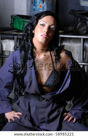 Sexy young female garage worker - stock photo