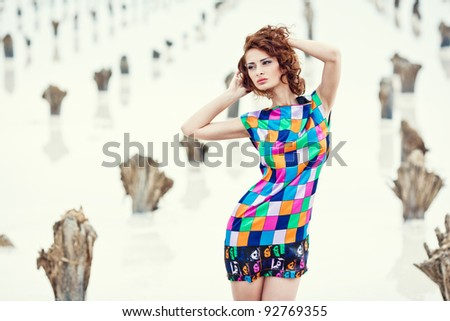 Sexy young girl in a deserted place - stock photo