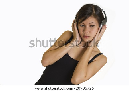 Sexy young girl listening to music on headphones