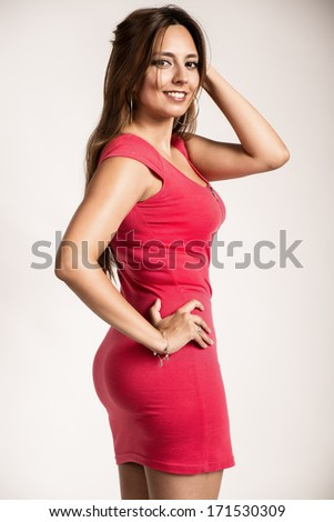 Sexy young girl wearing a red dress