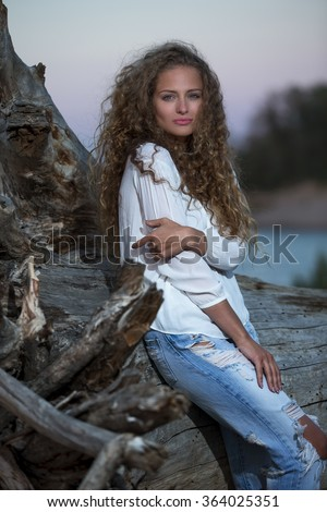 Sexy young girl with curly hair - stock photo